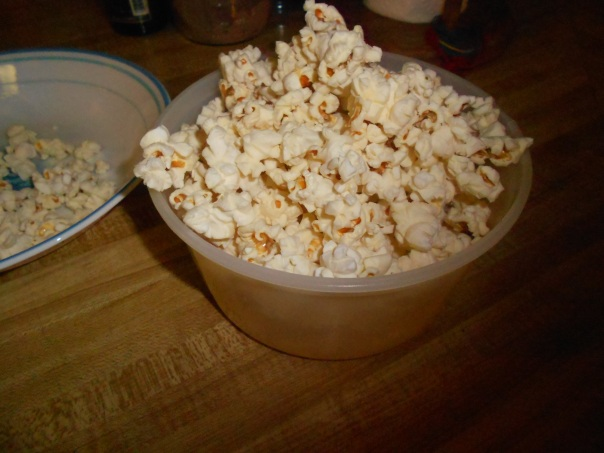 In retrospect I probably should have found a nicer bowl to put my popcorn in, rather than an old sherbet container...but hey, this is the Poor Couple's Food Guide, not the Ritz.