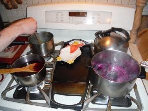 Four stove burners = hot kitchen